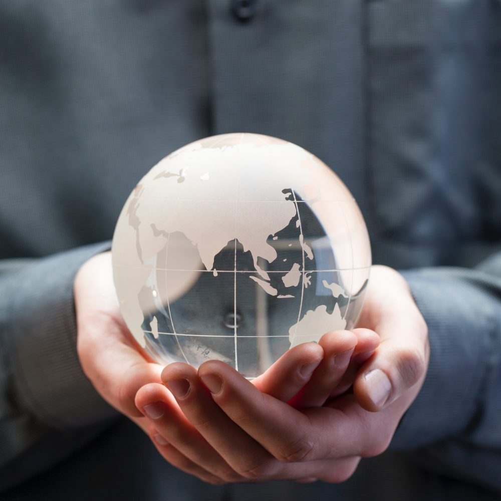 glass globe in palm of hands